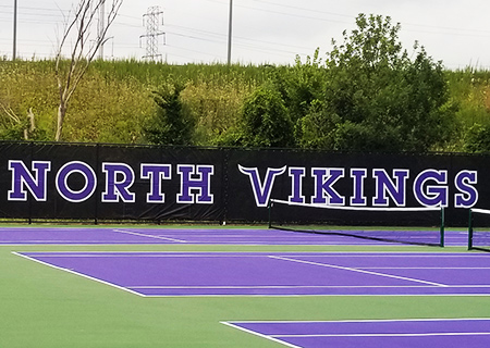School logos on multiple tennis courts
