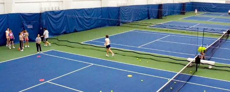 Indoor tennis upgrades: backdrop curtains, padding, and netting